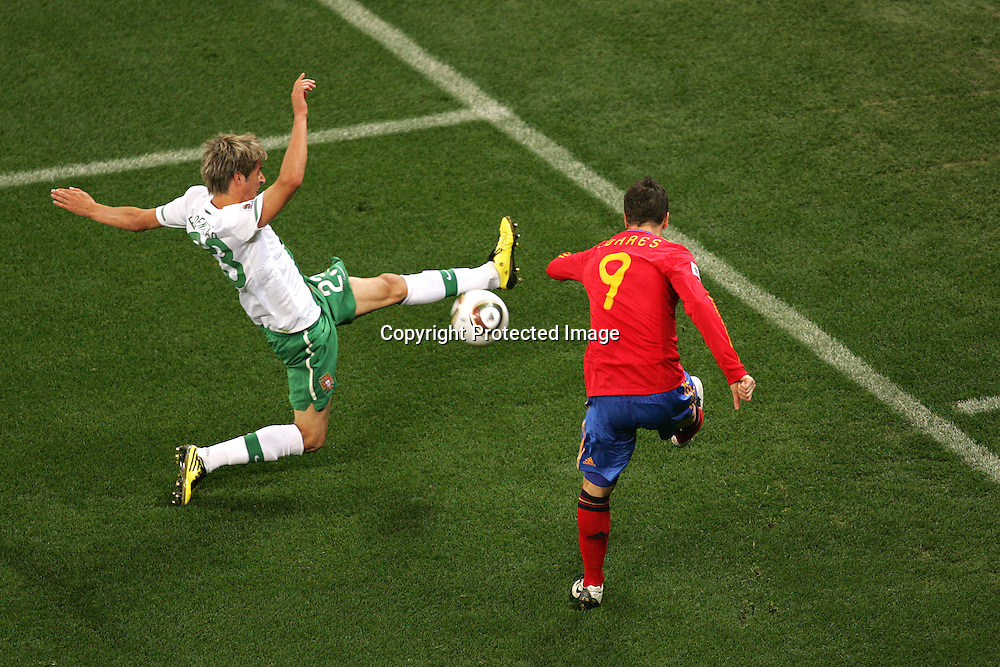 Fabio Coentrao of Portugal blocks the cross of Fernando Torres of Spain  during the FIFA World Cup 2010 last 16 match between Spain and Portugal held at The Cape Town Stadium in Green Point, Cape Town, South Africa on the 29th June 2010<br /> <br /> <br /> Photo by Ron Gaunt/SPORTZPICS