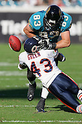 JACKSONVILLE, FL - DECEMBER 12:  Safety Mike Green #43 of the Chicago Bears knocks the ball loose on a pass to tight end Todd Yoder #83 of the Jacksonville Jaguars on December 12, 2004 at Alltel Stadium in Jacksonville, Florida. The Jags defeated the Bears 22-3. ©Paul Anthony Spinelli *** Local Caption *** Mike Green;Todd Yoder