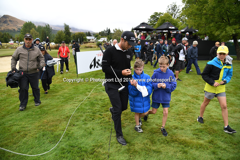 New Zealand's Ben Campbell and young fans on day 4 at the 2017 ISPS Handa New Zealand Golf Open. Millbrook, Arrowtown. New Zealand. Sunday 12 March 2017. © Photo: Andrew Cornaga / www.photosport.nz
