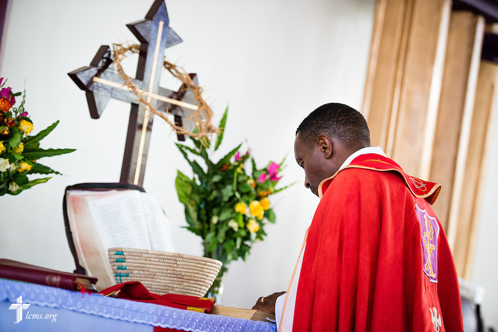 Bishop Emmanuel Makala prays during service on Sunday, March 15, 2015, at the Evangelical Lutheran Church in Tanzania – South-East of Lake Victoria Diocese's (ELCT-SELVD) Ebenezer Cathedral in Shinyanga, Tanzania. LCMS Communications/Erik M. Lunsford