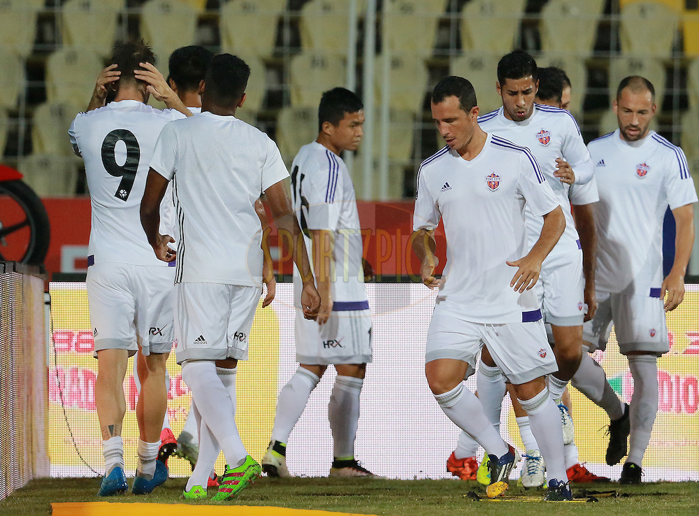 FC Pune City players warm up before the start of the match 8 of the Indian Super League (ISL) season 3 between FC Goa and FC Pune City held at the Fatorda Stadium in Goa, India on the 8th October 2016.<br /> <br /> Photo by Vipin Pawar / ISL/ SPORTZPICS