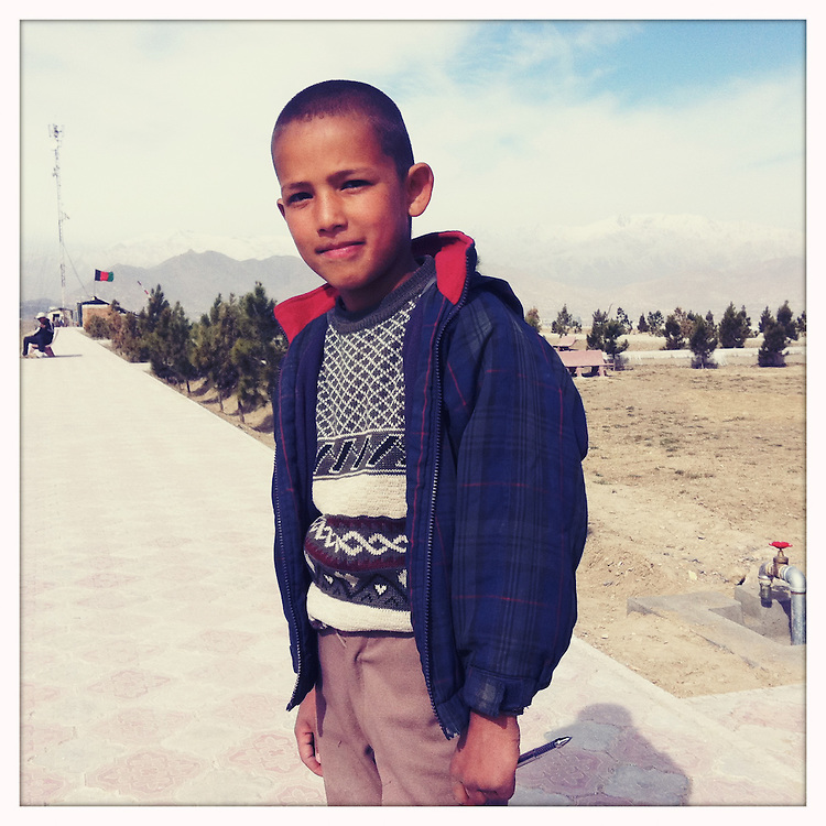 A boy poses for a portrait.