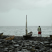 Canoes used for fishing, lying in the rocky beaches of the São Tomé north shore.