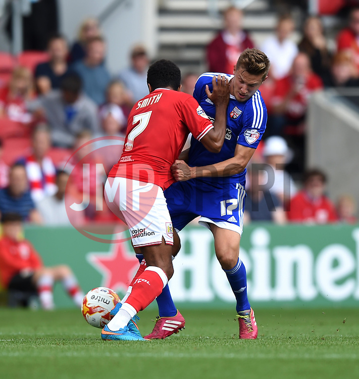 Korey Smith of Bristol City battles with Konstantin Kerschbaumer of Brentford - Mandatory by-line: Paul Knight/JMP - Mobile: 07966 386802 - 15/08/2015 -  FOOTBALL - Ashton Gate Stadium - Bristol, England -  Bristol City v Brentford - Sky Bet Championship