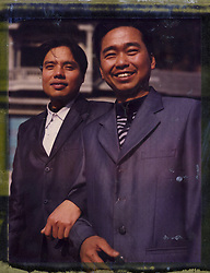 Polaroid 79's portrait of two young men wearing suit