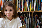 Little Girl Reading in the Library