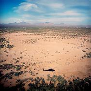 Border patrol blackhawk patrols the desert near the US-Mexico Border.Arizona.12/0/05..photo: Hector Emanuel.