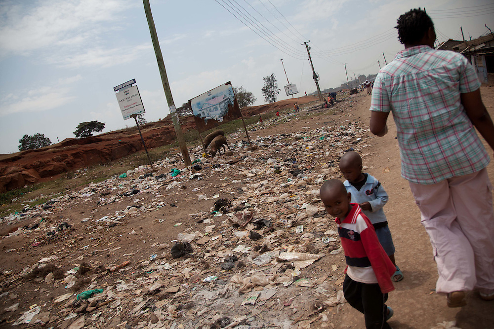 Children walk along empty lots near the perimeter of Mathere as Beatrice passes by.