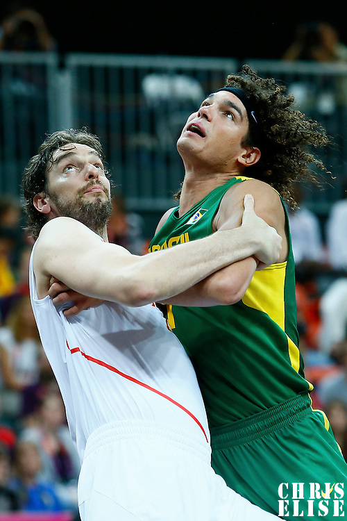 06 August 2012: Spain Pau Gasol vies for the rebound with Brazil Anderson Varejao during 88-82 Team Brazil victory over Team Spain, during the men's basketball preliminary, at the Basketball Arena, in London, Great Britain.