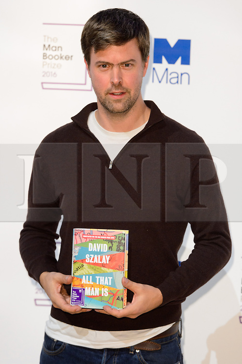 © Licensed to London News Pictures. 24/10/2016. Author DAVID SZALAY with his book titled All That Man Is attends the Man Booker Prize for Fiction photocall. London, UK. Photo credit: Ray Tang/LNP
