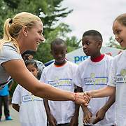 August 15, 2014, New Haven, CT:<br /> Dominika Cibulkova meets kids from the New HYTEs youth development organization during the draw ceremony at the 2014 Connecticut Open at the Yale University Tennis Center in New Haven, Connecticut Friday, August 15, 2014.<br /> (Photo by Billie Weiss/Connecticut Open)
