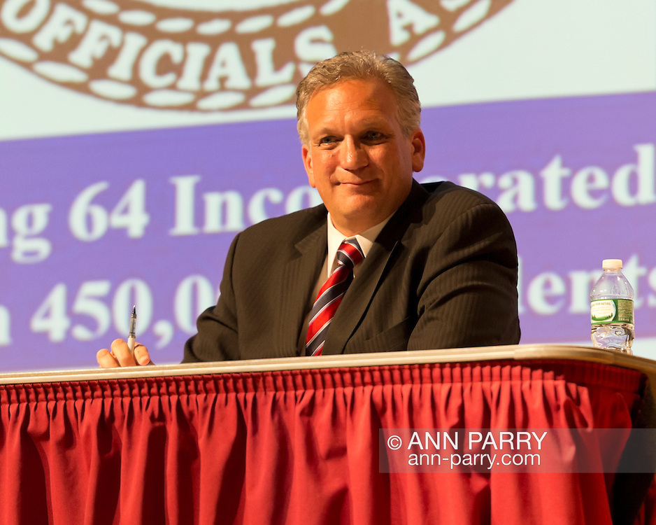 Old Westbury, New York, U.S. 8th October 2013. Republican EDWARD MANGANO, the Nassau County Executive, debates with former Nassau County Executive Suozzi at debate hosted by the Nassau County Village Officials Association, representing 64 incorporated villages with 450,000 residents, as the opponents face a rematch in the 2013 November elections.