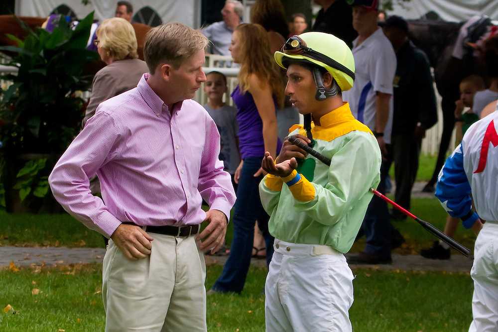 David Duggan, trainer, meets with his jockey, Rajif Miragh, in the paddock before the up and coming race.