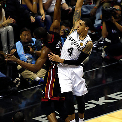 Jun 16, 2013; San Antonio, TX, USA; San Antonio Spurs shooting guard Danny Green (4) shoots against Miami Heat center Chris Bosh (1) during the first quarter of game five in the 2013 NBA Finals at the AT&T Center. Mandatory Credit: Derick E. Hingle-USA TODAY Sports