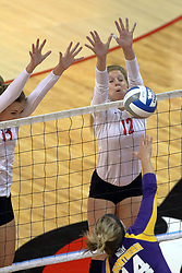 17 October 2014:  Eliza Smith & Emily Schneider work to thwart and attack by Eryca Higtgen during an NCAA Missouri Valley Conference (MVC) womens volleyball match between the Northern Iowa Panthers and the Illinois State Redbirds for 1st place in the conference at Redbird Arena in Normal IL