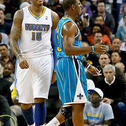 October 29, 2010; New Orleans, LA, USA; Denver Nuggets small forward Carmelo Anthony (15) and New Orleans Hornets point guard Chris Paul (3) on the court during the fourth quarter at the New Orleans Arena. The Hornets defeated the Nuggets 101-95.  Mandatory Credit: Derick E. Hingle
