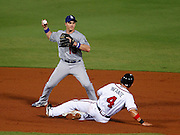 ATLANTA - AUGUST 13:  Second baseman Omar Infante #4 of the Atlanta Braves is forced out at second by second baseman Ryan Theriot #13 of the Los Angeles Dodgers during the game at Turner Field on August 13, 2010 in Atlanta, Georgia.  (Photo by Mike Zarrilli/Getty Images)