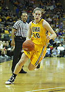 January 08 2010: Iowa forward Kelly Krei (20) drives with the ball during the first half of an NCAA womens college basketball game at Carver-Hawkeye Arena in Iowa City, Iowa on January 08, 2010. Iowa defeated Ohio State 89-76.