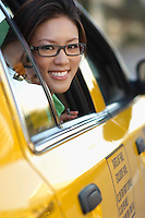 Woman in glasses looking out taxi window