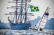 Nacra 17 sailors Jason Saunders and Gemma Jones from New Zealand sail past a Brazilian tall ship as they sail in a practice race in Guanabara Bay in Rio de Janeiro, Brazil, 02 August 2016. Sailing events at 2016 Olympic Games start on 08 August.