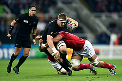 Sam Cane of New Zealand is tackled - Mandatory byline: Patrick Khachfe/JMP - 07966 386802 - 09/10/2015 - RUGBY UNION - St James' Park - Newcastle, England - New Zealand v Tonga - Rugby World Cup 2015 Pool C.