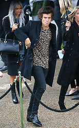 Harry Styles from One Direction arriving at the LFW: Burberry Prorsum - s/s 2014 catwalk show at Kensington Gardens, Kensington Gore in London, UK. 16/09/2013<br />