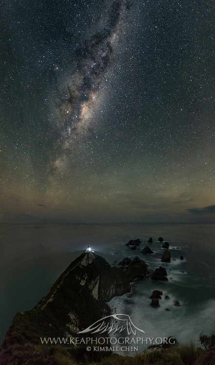 A 5-image panoramic of the Milky Way dwarfing Nugget Point Lighthouse, in the Catlins, South Island, New Zealand.