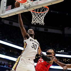 Oct 11, 2018; New Orleans, LA, USA; New Orleans Pelicans forward Julius Randle (30) shoots oer Toronto Raptors center Eric Moreland (1) during the first half at the Smoothie King Center. Mandatory Credit: Derick E. Hingle-USA TODAY Sports