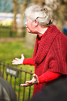 A woman speaks to the crowd at Speaker's Corner in Hyde Park, London, England.