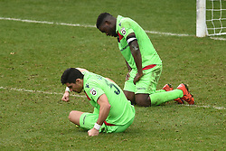 Oxford City's Cristian Navarro (left) and Godfrey Poku dejected after conceding the winning goal