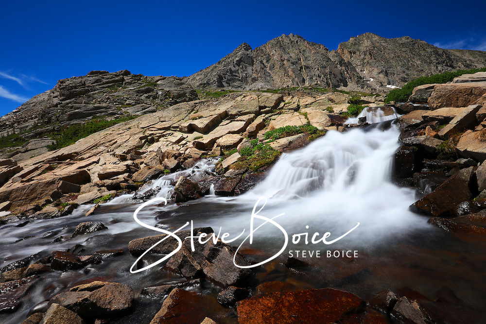 An alpine waterfall along the Mitchell Lake Trailhead in the Indian Peaks Wilderness, Colorado.