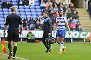 Reading FC midfielder Hal Robson-Kanu leaves the field injured during the Sky Bet Championship match between Reading and Cardiff City at the Madejski Stadium, Reading, England on 19 March 2016. Photo by Mark Davies.