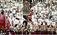 South Carolina's Sindarius Thornwell (0) makes a shot over Texas A&M's Danuel House (23) during the first half of an NCAA college basketball game, Saturday, Feb. 6, 2016, in College Station, Texas. South Carolina won 81-78. (AP Photo/Sam Craft)