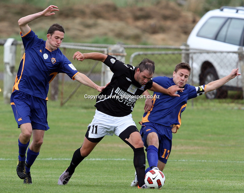 Cole Peverley struggles through the Otago United defence.<br /> ASB Premiership Football - Otago United v Hawke's Bay United, 23 January 2011, Tahuna Park, Dunedin, New Zealand.<br /> Photo: Rob Jefferies / www.photosport.co.nz