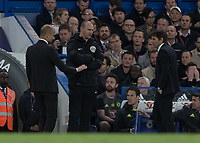Football - 2016 / 2017 Premier League - Chelsea vs. Manchester City<br /> <br />  Pep Guardiola Manager of Manchester City would appear to be apologising to Chelsea Manager Antonio Conte after the 2 had words  <br /> at Stamford Bridge.<br /> <br /> COLORSPORT/DANIEL BEARHAM