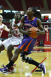 01 January 2012:  Taylor Ware drives to the lane defended by Candace Sykes during an NCAA women's basketball game between the Evansville Purple Aces and the Illinois Sate Redbirds at Redbird Arena in Normal IL