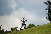 Alicea Carimbocas runs up the hill at Danehy Park in Cambridge, July 14, 2015.