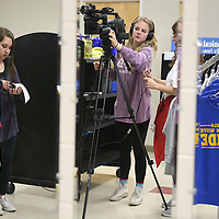 Lauren Wood | Buy at photos.djournal.com<br /> Leah Sevilla, left, Lexi Pund, center, and Mamie Clark setup the camera to interview DECA student Anna Kirk Presley on a video package about the marketing competition.