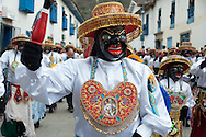 """Feast of """"Mamacha del Carmen"""" of Paucartambo. The Qhapaq negro is a group dance that recalls the African slaves who during colonial times woked in the """"haciendas"""""""