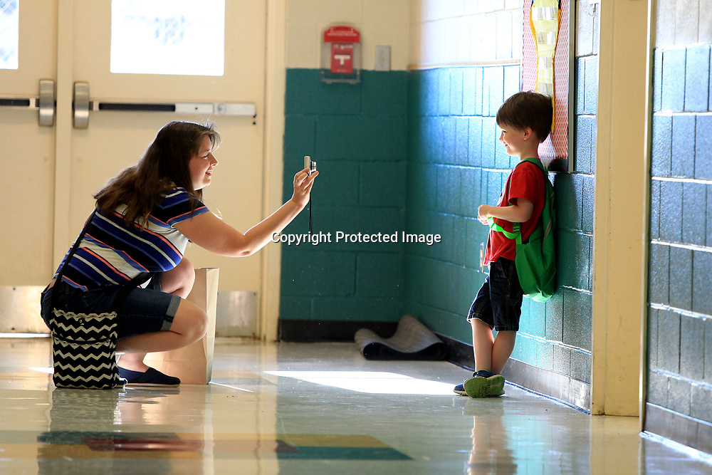 Rae LaDue, gets a picture of her son, Austin, before walking into his first day of kindergarten in Mrs. Anna McCarley's class at Saltillo Primary School Thursday morning.