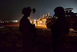 May 4, 2014 - Sangin, Helmand, Afghanistan - Several Marines setup a security perimeter as they await the orders to move out on the 100km convoy back to Camp Leatherneck.  The op involve moving 174 vehicles and 700 Marines from Sangin to Camp Leatherneck about 100km.  About 400 of the 700 Marines are assigned to Camp Leatherneck and arrived into Sangin in support of the operation. Hand-off in northern Helmand comes as NATO combat mission wanes. The last U.S. Marines withdrew from northern Helmand early Monday morning, turning their two remaining bases in the hard-fought Sangin district over to Afghan national security forces.  (Credit Image: © U-T San Diego/ZUMAPRESS.com)