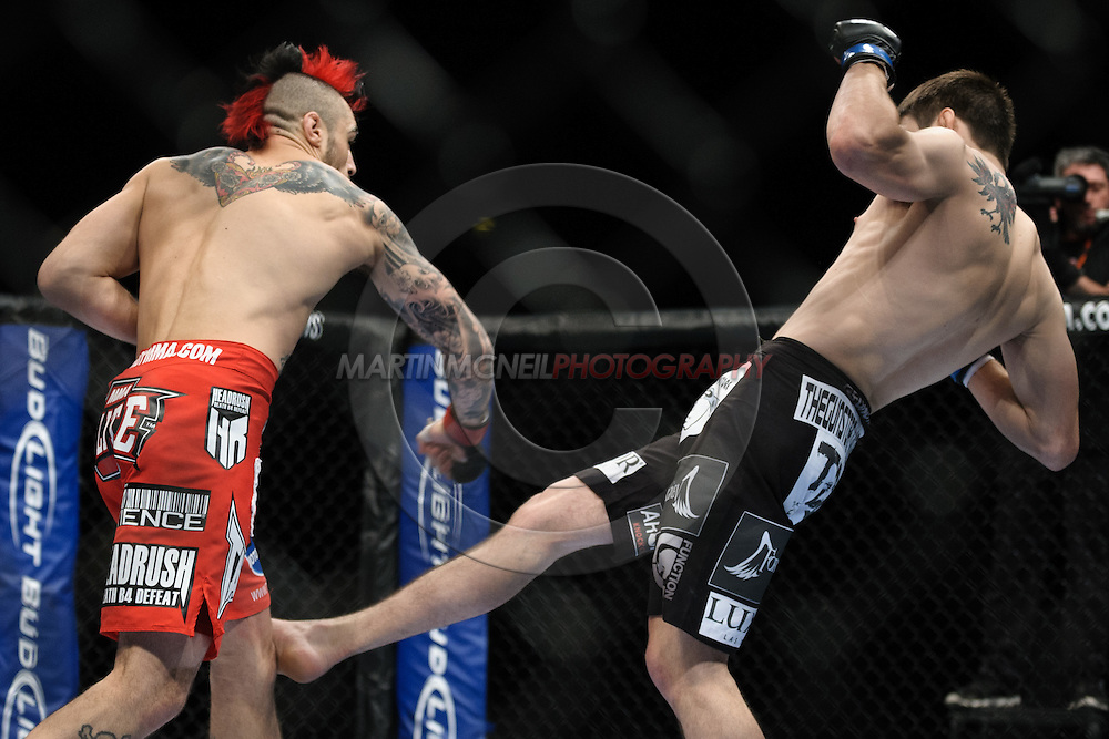 """LONDON, ENGLAND, OCTOBER 2010: Dan Hardy (left) and Carlos Condit trade blows during """"UFC 120: Bisping vs. Akiyama"""" inside the O2 Arena in Greenwich, London"""