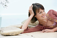 Smiling woman resting by beach