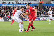defender Angel Rangel and defender Dave Winfield tackle for the ball during the Capital One Cup match between Swansea City and York City at the Liberty Stadium, Swansea, Wales on 25 August 2015. Photo by Simon Davies.