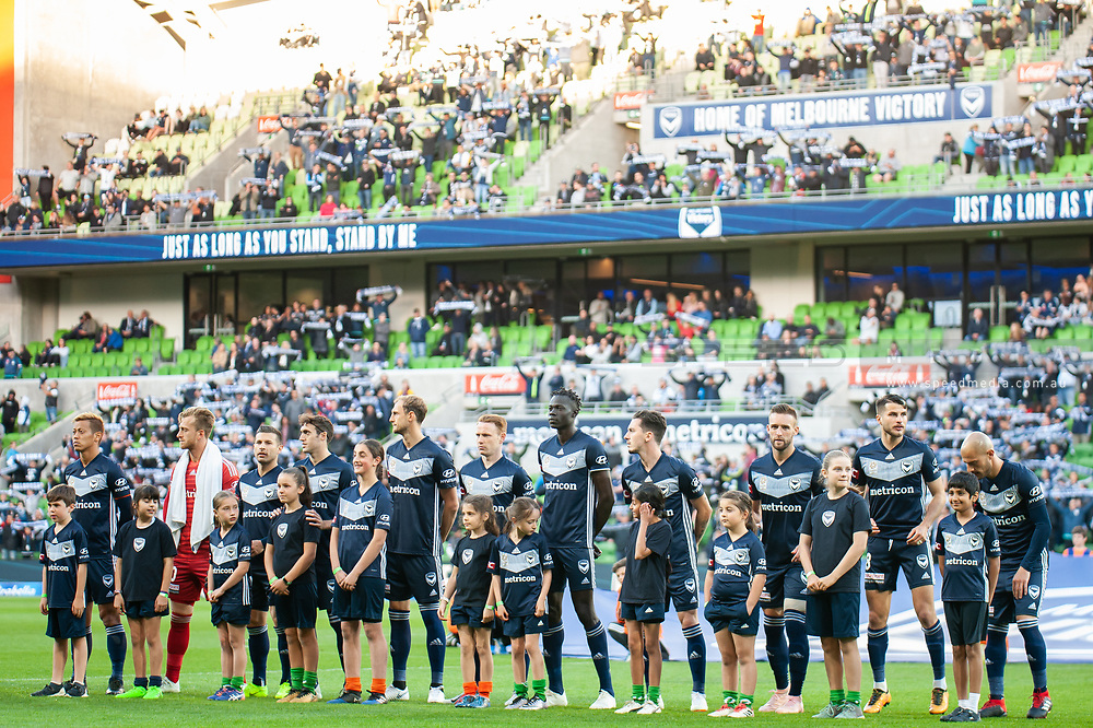 Melbourne Victory line up before the match at the Hyundai A-League Round 2 soccer match between Melbourne Victory and Perth Glory at AAMI Park in Melbourne.