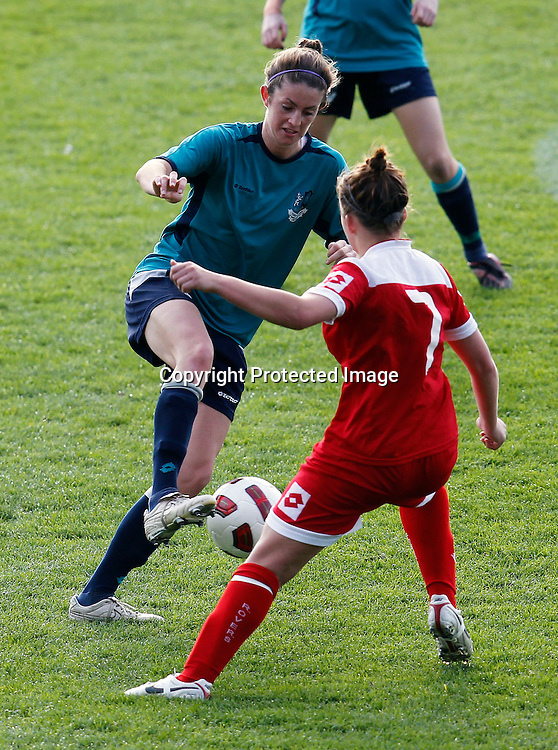 Kings Chelsey Wood controls the ball ahead of Rovers Grace Parkinson. Women's Knockout Cup Final, Three Kings United v Claudelands Rovers, North Harbour Stadium, Albany, Sunday 19th September 2010. Photo: Shane Wenzlick/PHOTOSPORT