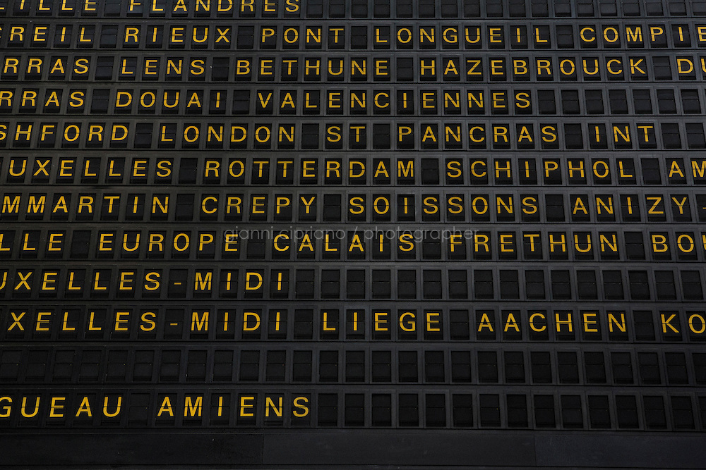 PARIS, FRANCE - 19 NOVEMBER 2014: The departure board of the Gare du Nord train station, where migrants take trains to Calais, Belgium or the Netherlands in Paris, France, on November 19th 2014.<br /> <br /> After crossing the Italian-French border, migrants take the train to Paris. Some stop in Paris, but the majority continues the journey to Calais (before arriving in London), while others go to countries such Germany, the Netherlands, and Sweden.