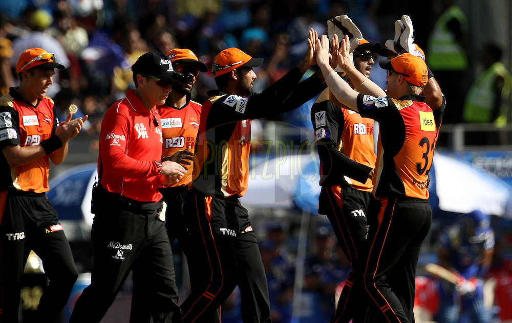 Sunrisers Hyderabad players celebrates the wicket of Mumbai Indians player Parthiv Patel during match 23 of the Pepsi IPL 2015 (Indian Premier League) between The Mumbai Indians and The Sunrisers Hyderabad held at the Wankhede Stadium in Mumbai India on the 25th April 2015.<br /> <br /> Photo by:  Vipin Pawar / SPORTZPICS / IPL