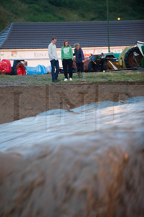 © Licensed to London News Pictures. 06/09/2013<br /> <br /> Saltburn, Cleveland, England<br /> <br /> People look on as heavy flooding washes away a river bank in Saltburn in Cleveland.<br /> <br /> Photo credit : Ian Forsyth/LNP