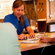 silver moon brewing bartender giving bend ale trail stamps